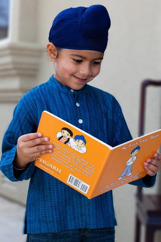 Sikh Boy reading a book